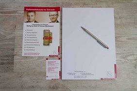Flyer, Visitenkarten und Schreibblock im Corporate Design